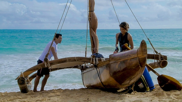 """""""Mo'o 'olelo Pu"""" -- When Kono goes on a solo outrigger trip around the Hawaiian islands in honor of her mother, she hits a patch of wild weather and must fight to stay alive. As Five-0 searches for Kono, they investigate a man busted for cooking meth who claims he received a threat on his son's life if he didn't continue making the drug, on HAWAII FIVE-0, Friday, May 1 (9:00-10:00 PM, ET/PT), on the CBS Television Network . Pictured (l-r) Daniel Dae Kim as Chin Ho Kelly and Grace Park as Kono Kalakaua Photo: Best Possible Screen Grab/CBS ©2015 CBS Broadcasting, Inc. All Rights Reserved"""